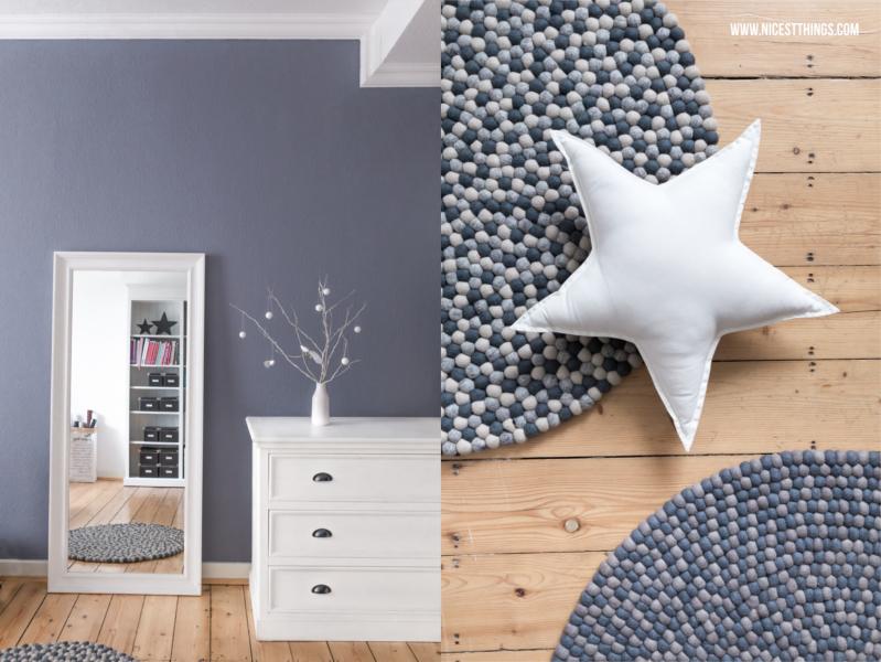 weiße Kommode vor grauer Wand und Kugelteppich Filzkugelteppich