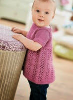 http://www.letsknit.co.uk/free-knitting-patterns/LK69-girls-pinafore-dress-Menzies