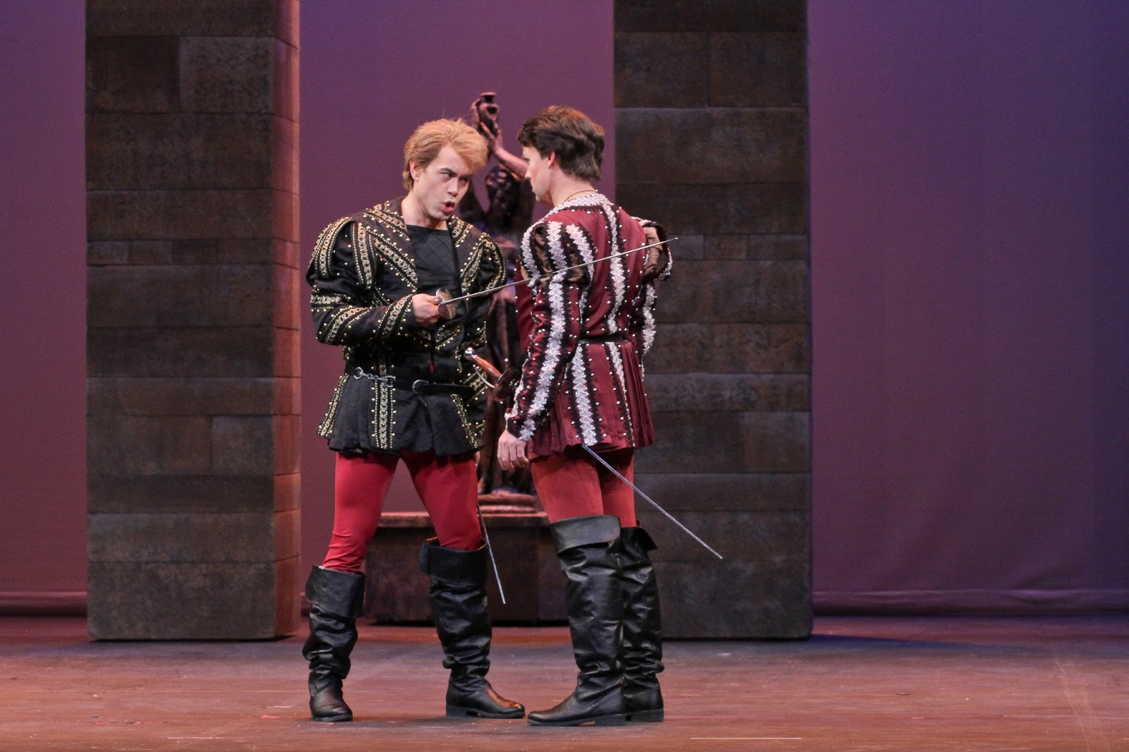 IN PERFORMANCE: Tenors BRIAN ARREOLA as Tybalt (left) and JONATHAN BOYD as Roméo (right) in Opera Carolina's production of Charles Gounod's ROMÉO ET JULIETTE, January 2016 [Photo by Jon Silla, © by Opera Carolina]