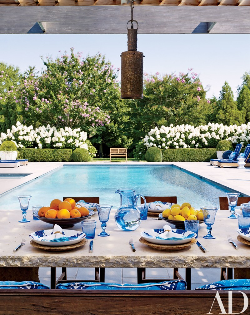 outdoor living, dining area and poolhouse