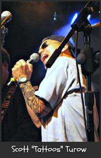 Rock Bottom Remainders: Scott Turow, wearing a tattoo sleeve