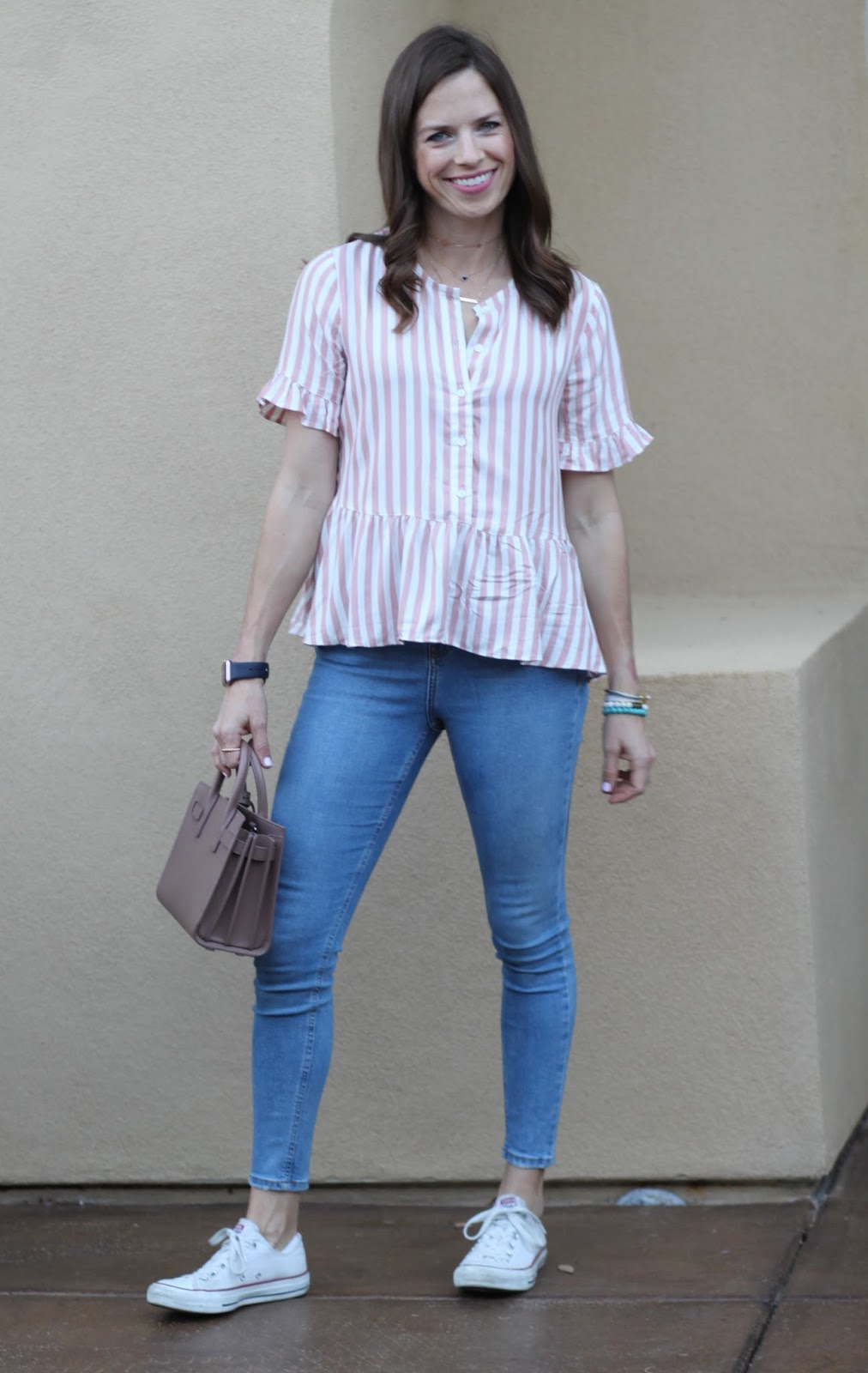 striped peplum top and white sneakers outfit