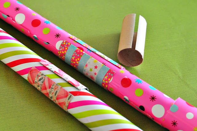 Keep wrapping paper neat with empty toilet paper rolls, organizing with toilet paper rolls
