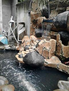 Tukang kolam air mancur