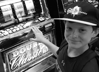 Kid On Slot Machine.