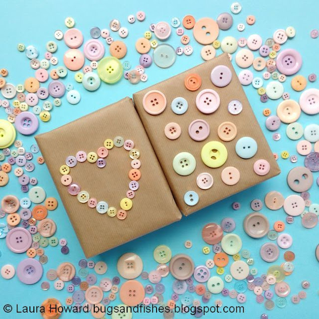 Button gift wrapped parcels surrounded by lots of buttons