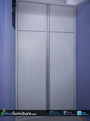 Lemari 2 pintu model bukaan dengan Lis aluminium