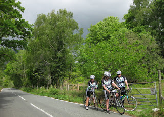 Three riders from the Gwernyfed  RFC, heading south on a two-day ride, near Beddgelert, Wales