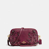 http://www.coach.com/coach-designer-cases-willow-floral-crossbody-clutch-in-pebble-leather/66155.html?dwvar_color=LIBUR&search=true