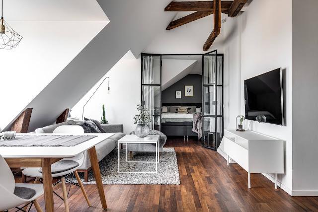Mansardă de 51 m² cu decor scandinav în alb, negru și gri