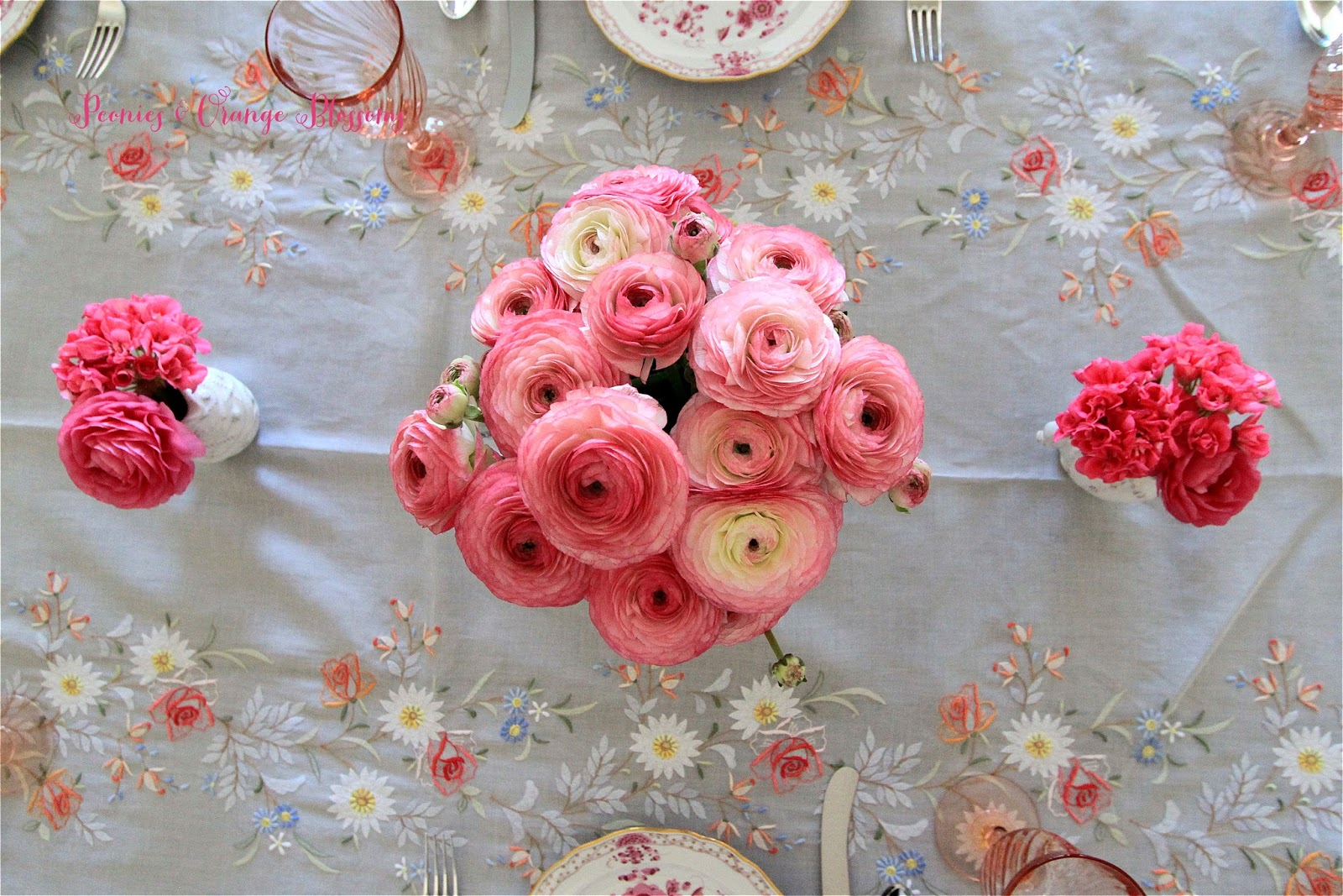 French table setting with pink ranunculus