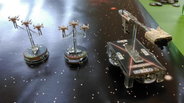 Nebulon-B frigate and X-Wing escort squadron
