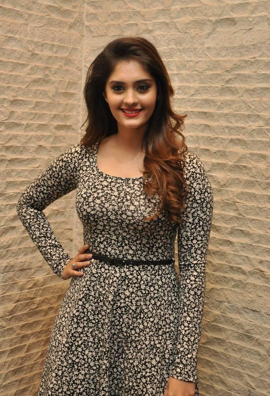 Surabhi Long Hair In Black Dress At Mobile Launch