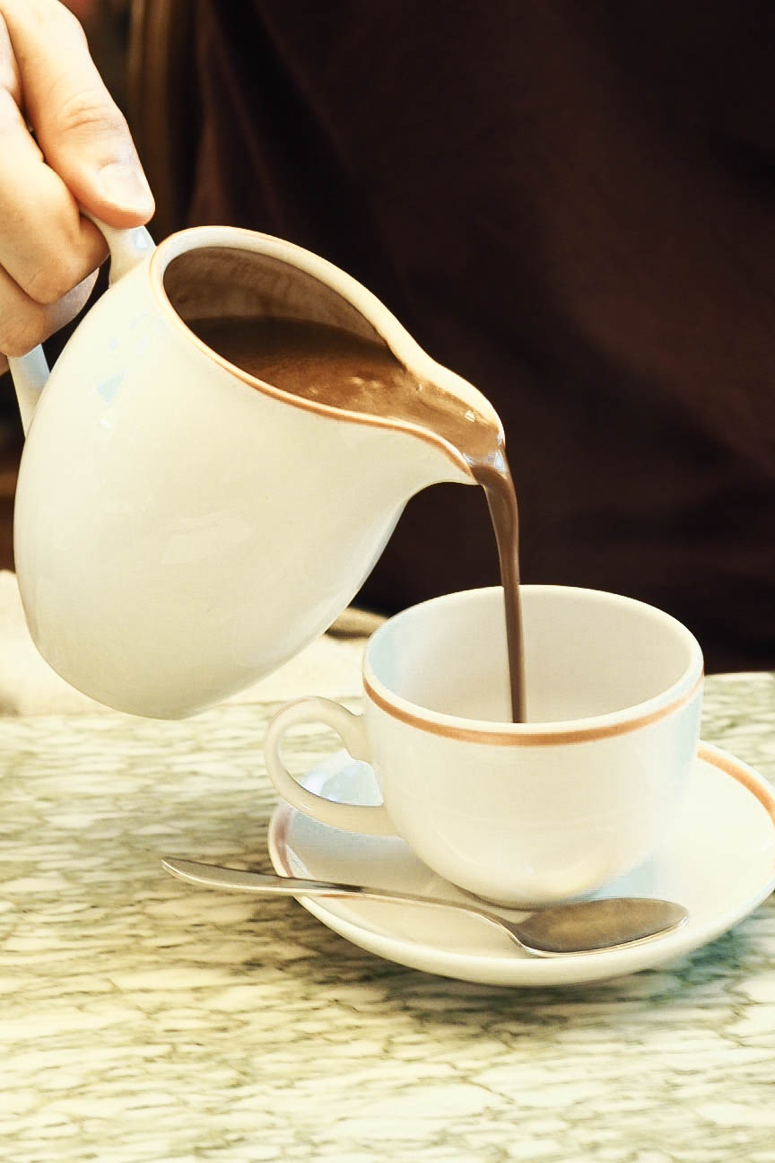 Pouring hot chocolate from a jug