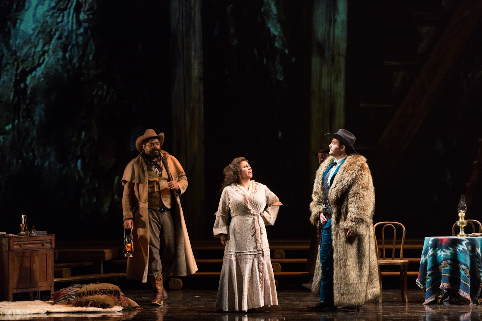 IN PERFORMANCE: (from left to right) Bass-baritone JASON S. MCKINNEY as Ashby, soprano KRISTIN SAMPSON as Minnie, and baritone ALEKSEY BOGDANOV as Jack Rance in Opera Carolina's production of Giacomo Puccini's LA FANCIULLA DEL WEST, April 2017 [Photo by Mitchell Kearney, © by Opera Carolina]