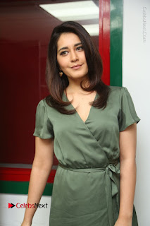 Actress Raashi Khanna Stills in Green Short Dress at Mirchi 95 Suno Aur Mercedes Jeeto Contest  0095.JPG