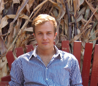 handsome son in garden corn stalks drying for seed caroline gerardo
