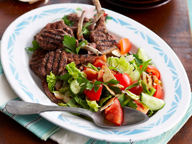 Lamb cutlets with fattoush in a serving plate