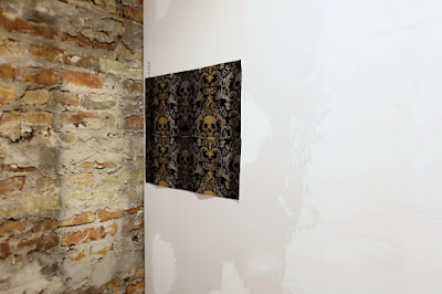 skull wallpaper sample exposed brick new drywall