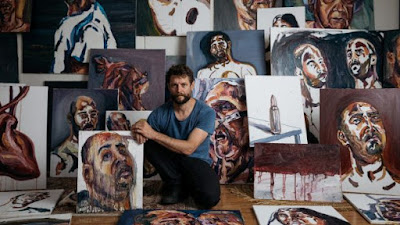 Artist Ben Quilty surrounded by works painted by Myuran Sukumaran