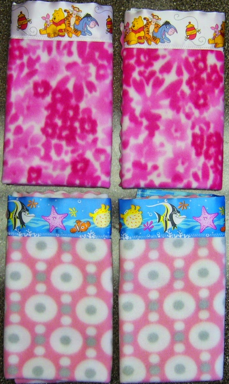 Winnie the Pooh satin binding on mini blanket loveys for Operation Christmas Child shoeboxes.