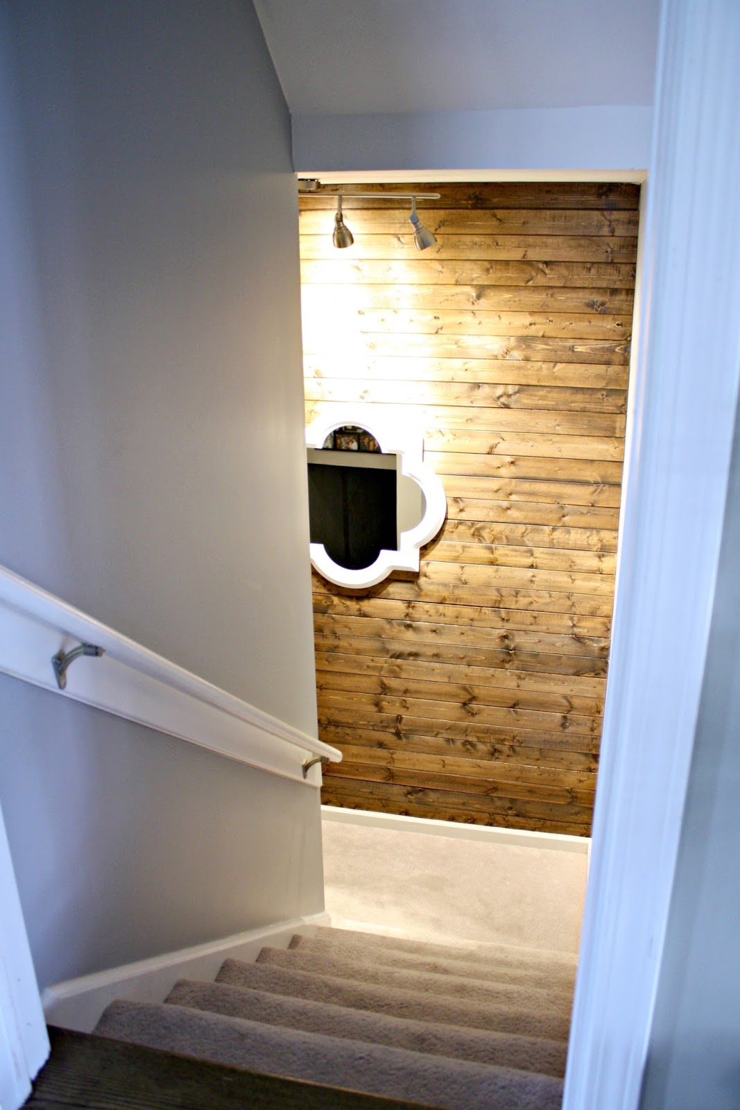 Stained wood wall on stairs