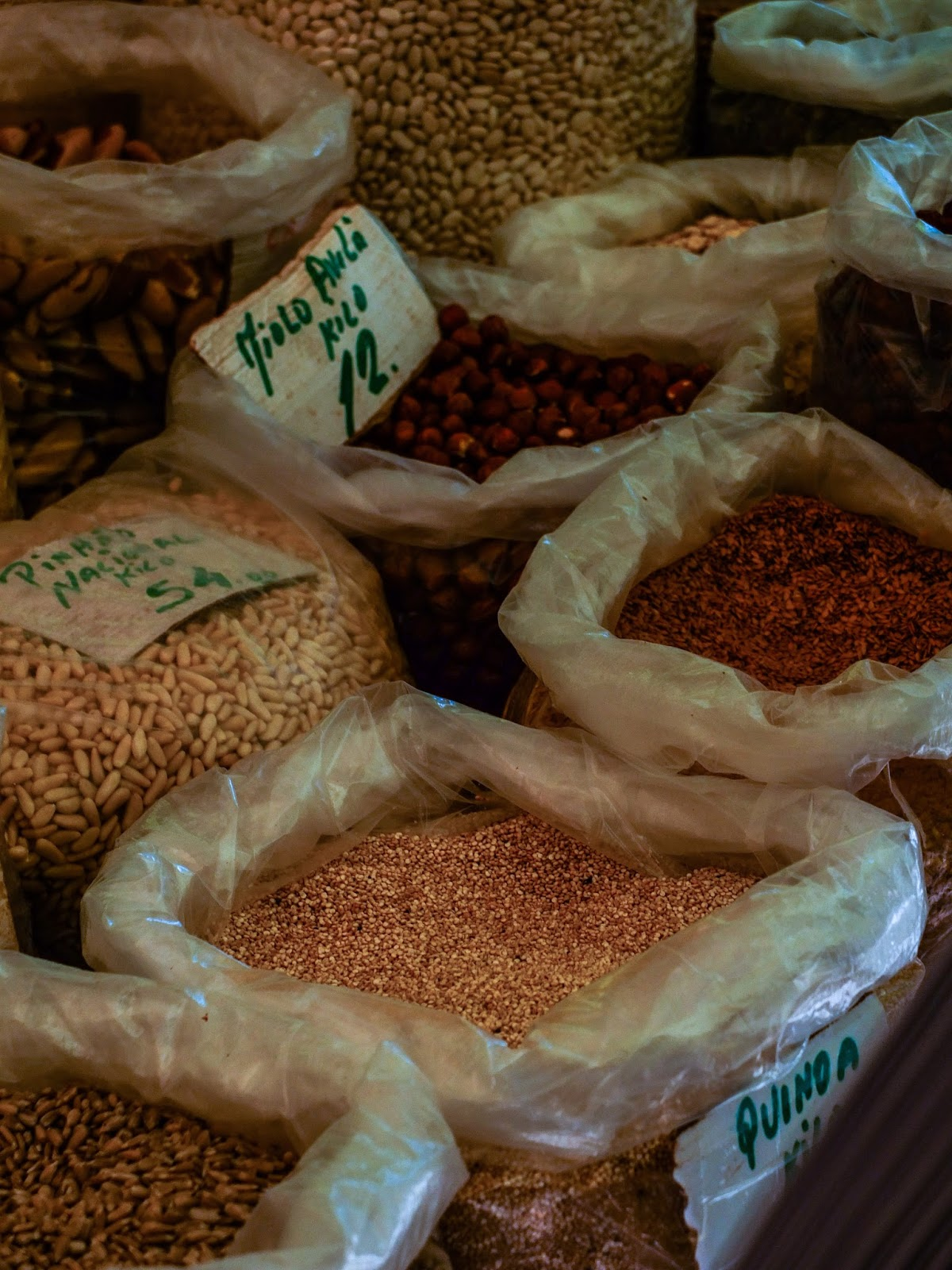 Quinoa and other grains in bags at a market in Porto, Portugal.