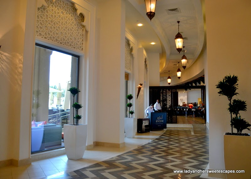 the elegant hallway leading to Encore Bistro