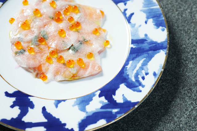 salmon carpaccio with sliced reddish pickles