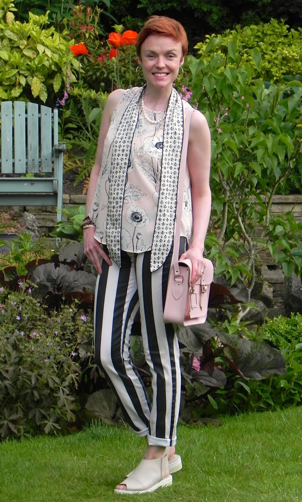 Black, white, pink, striped trousers