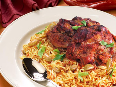 Add canned tomatoes with their juice Saudi Aseery Rice Recipe