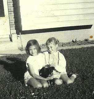 Photo of Two Girls With a Small Dog Taken in the Early 1960s