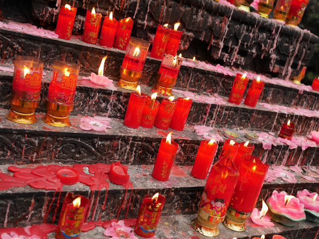 burning and consumed candles at Luohan Temple in Chongqing