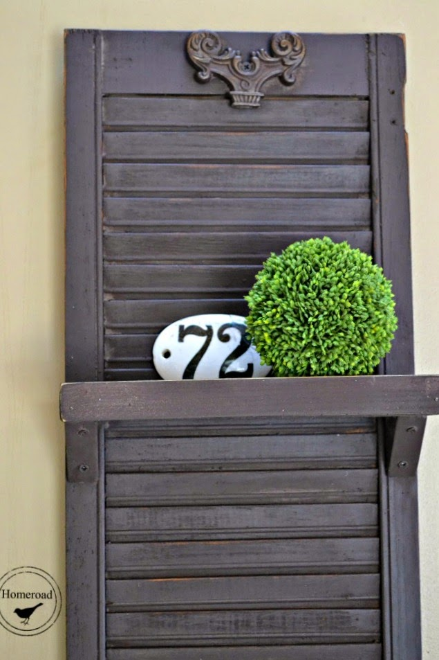 shelf made from a shutter with enamelware number