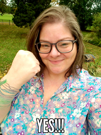image of me in my backyard, holding up a celebratory fist, to which I've added text reading: 'YES!!!'