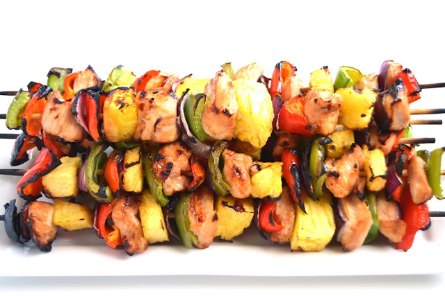 Hawaiian Chicken Kebabs are the perfect grilled dish with tangy marinaded chicken, fresh, juicy pineapple, colorful bell peppers and red onions! www.nutritionistreviews.com