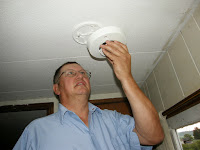 image of Jim Willisms installing a smoke detector