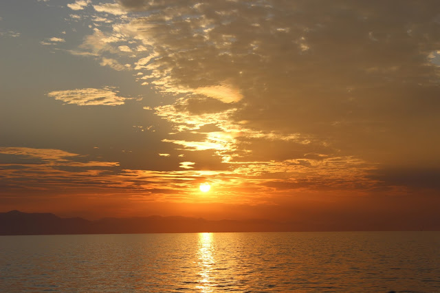 Watching the sun setting over Lake Malawi from Mufasa
