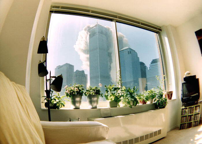 18 Rare Historical 9/11 Photos That You Most Possibly Haven't Seen Before - As Seen Through A Fish-Eye Lens From An Apartment Four Blocks Away, Smoke Streams From The North Tower Within Minutes Of The First Plane's Attack
