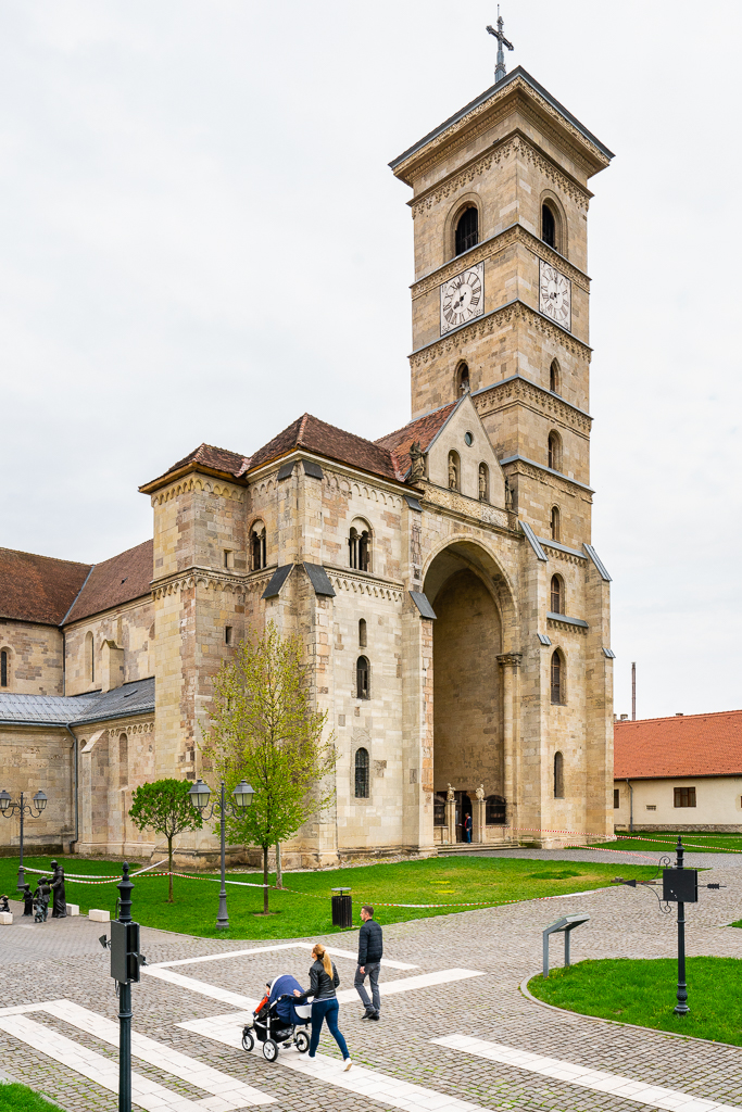 a photo of a family taking an Evening Stroll Past St. Michael's Cathedral in Alba Iulia Romania