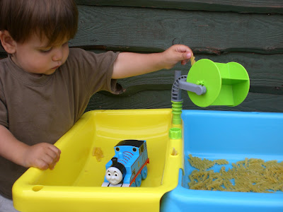 Child playing with a dry pasta table