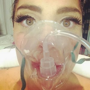Lady Gaga wears an oxygen mask on account of Evil Mountain