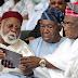 PHOTO: Abdulsalam Abubakar, Ernest Shonekan, Olusegun Obasanjo checking something on an Ipad