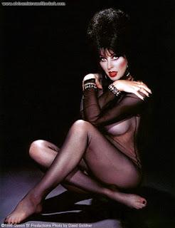 Elvira in full black body stocking