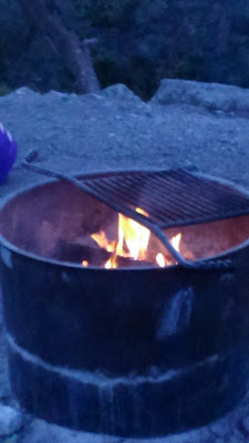 Fire in a steel drum from a campground