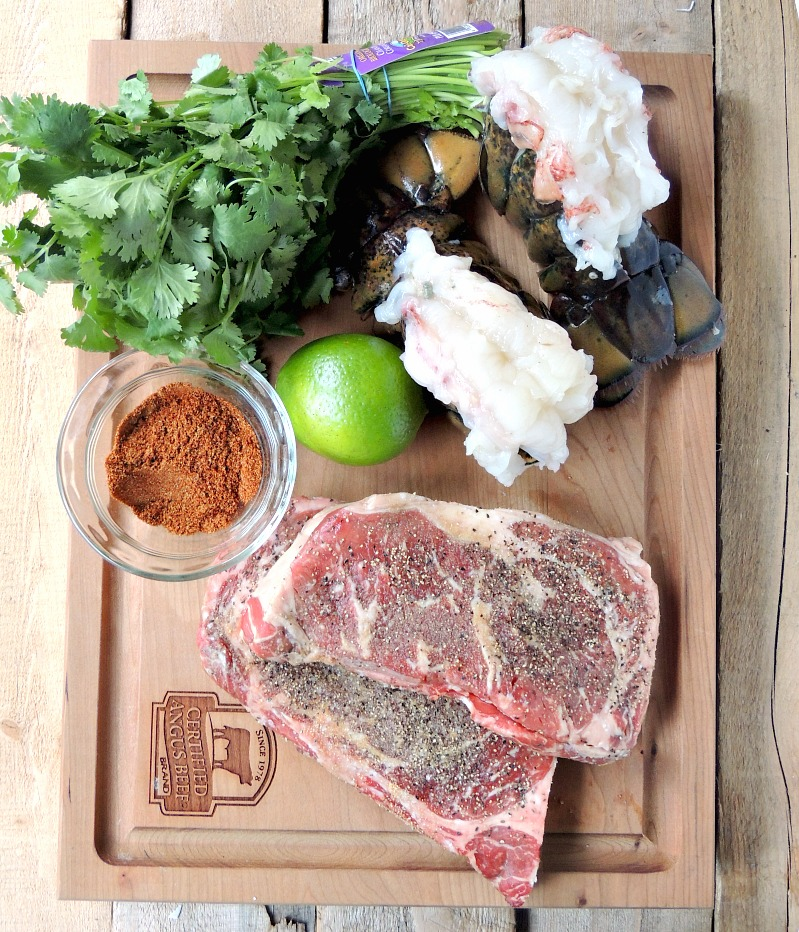 Ingredients to make Grilled Mexican Style Surf and Turf on a wooden cutting board.