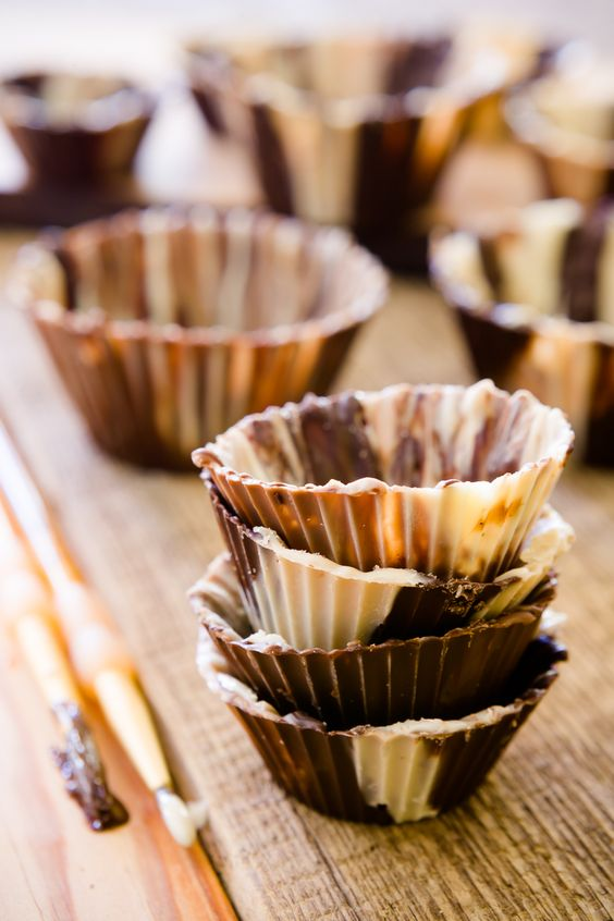 Making chocolate cups is so easy that even a toddler can do it! Learn how to make these pretty treat cups with your favorite chocolate.