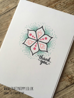 This image is a photograph of a handmade card with a mandala-style device in the middle, stamped using the Eastern Beauty stamp set from Stampin' Up! and shades of green and pink.