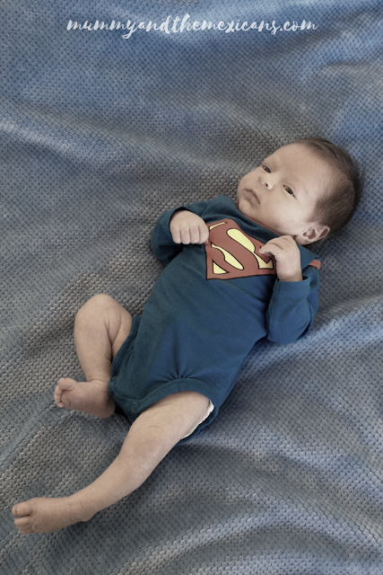 My Mexican Pregnancy - Birth Story - Image Shows Newborn Baby In Superman Babygro
