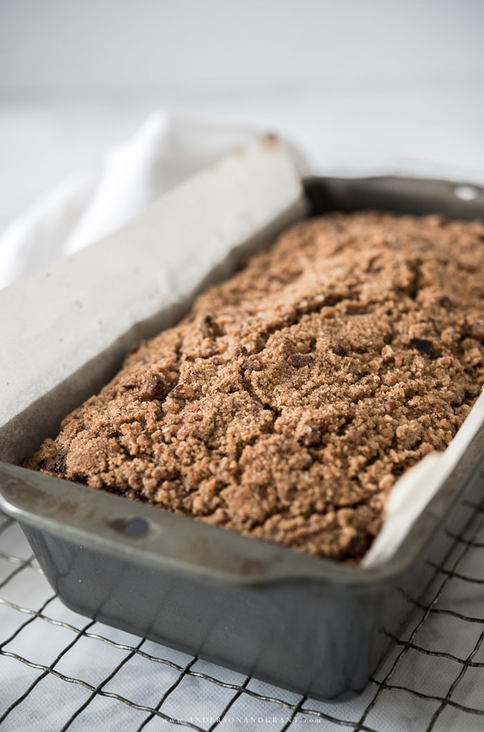 Banana bread resting in a loaf pan